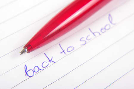handwrite: Back to school text written on the exercise book Stock Photo