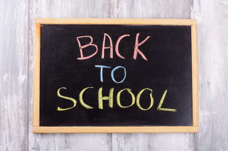 reclaimed: Blackboard with the text Back to school isolated on the reclaimed wood background