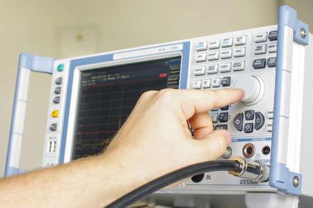 receiver: EMC engineer hand adjusting laboratory test receiver