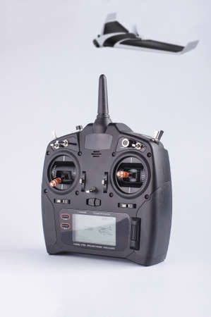 avionics: Drone telemetry controller and drone flying in the background Stock Photo