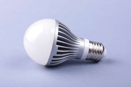 LED lamp isolated on the blue background Stock Photo
