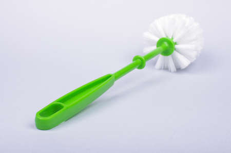 Toilet brush with green handle isolated