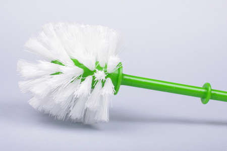 watercloset: Toilet brush with green handle isolated