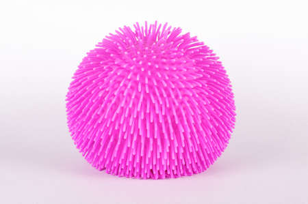 spiky: Spiky soft ball toy isolated on the white background Stock Photo