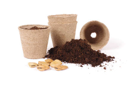 Argiculture concept: seads, heap of soil and peat pots Stock Photo