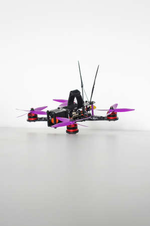aerodynamic: Racing quadcopter isolated on the white background