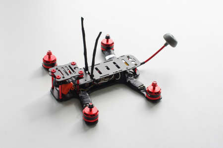 avionics: Racing quadcopter isolated on the white background
