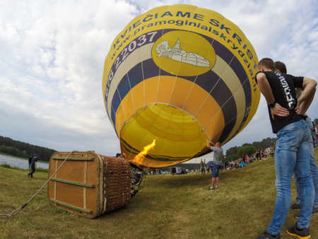 BIRSTONAS, LITHUANIA - JUNE 11, 2017: hot air ballon inflation and preparation for flight at Birstonas town festival in Birstonas, Lithuania