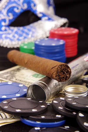 Poker chips domino mask and cigar gambling concept