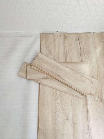 Close up of laminated flooring during replacing process