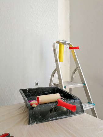 Flat renovation gluing wallpaper tools and equipment Stock Photo