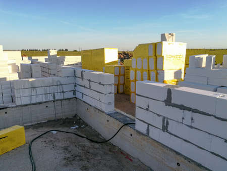 First stages of building a house. Half build from silicate blocks Stock Photo