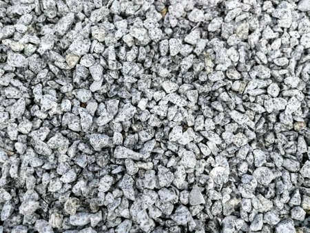 White gray granite break stone or gravel made from crushed rock for decoration abstract background