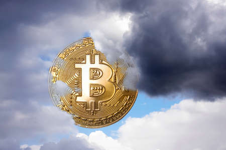 Bitcoin symbolic coin as a sun covered by clouds