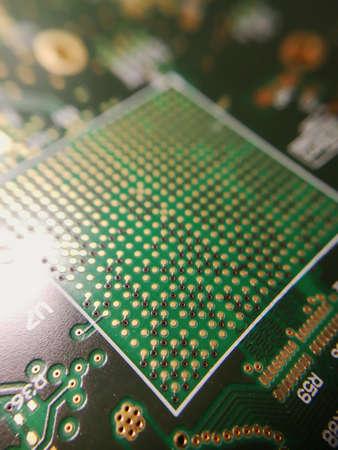 Macro close up of BGA ball grid array technology footprint on electronic printed circuit borad Stock Photo