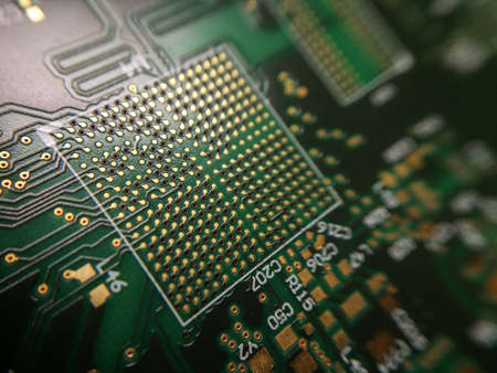 Macro close up of BGA ball grid array technology footprint on electronic printed circuit borad