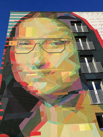 Kaunas/Lithuania - 12 October, 2018: Dadaistic Mona Lisa Mural modern painting on KTU Campus building wall created by Linas Kaziulionis