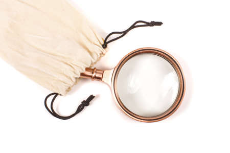 Old style magnifying glass loupe lens in cloth pouch