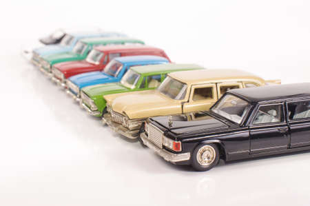 Collection of vintage metal die-cast car models isolated on the white background