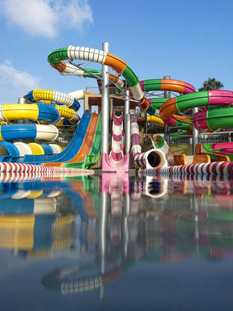 Colorful plastic water-slides in a swimming pool Stock Photo