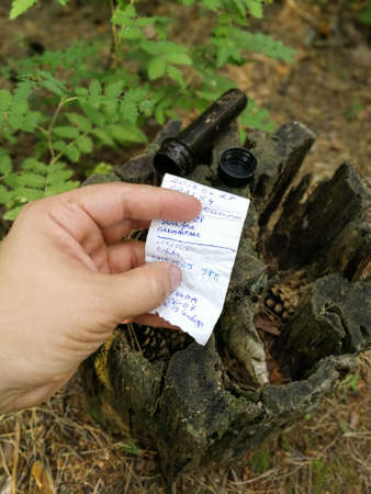 Geocaching activity treasure hunt game for searching symbolic treasures worldwide with gps