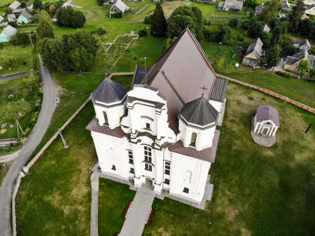 Kraziai church of st Mary of immaculate conception aerial photography from drone in Kraziai, Lithuania Фото со стока