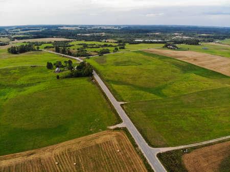 Aerial photography of autumn farm fields near Kraziai town in Lithuania