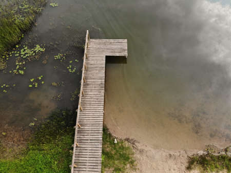 Aerial view of wooden bridge to the natural lake in Lithuania