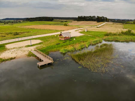 Aerial view of natural beach near lake in Kraziai during summer in Lithuania