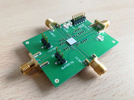 Radio frequency mixer printed circuit board for testing and evaluation on the wooden table