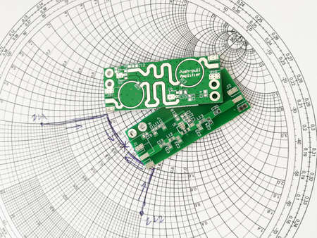 Radio frequency and microwave printed circuit board PCB in front of Smith chart