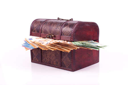 Many euro banknotes in the old retro chest isolated on the white background Archivio Fotografico
