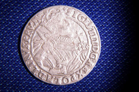Grand Duchy of Lithuania LDK silver coin Zigmundas Vaza III ort on the blue fabric background