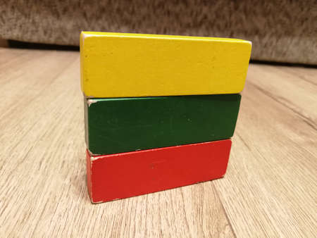 Lithuania flag constructed from 3 color wooden blocks as a toys. Patriotism concept Reklamní fotografie
