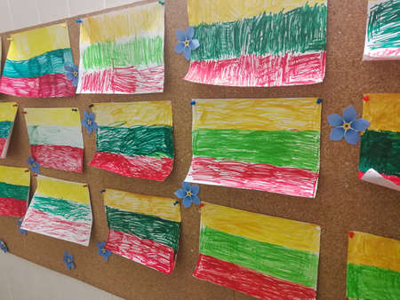 Many child drawings of Lithuania flags drawn with felt tip pens