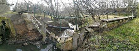 Broken concrete pedestrian bridge in Griciupis park in Kaunas, Lithuania