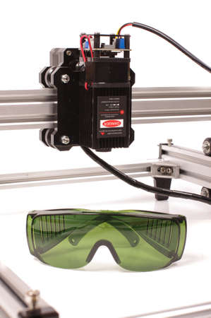 Safety green glasses for protection from laser radiation and high power laser close up Foto de archivo