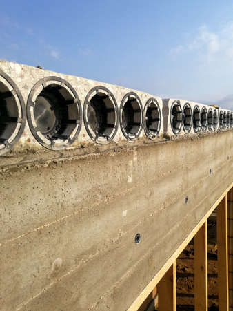 Concrete hollow core slabs close up at constructions site. Construction industry concept