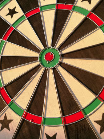 Dart wooden target hanged on the wall ready to play. Leisure activity Stock Photo