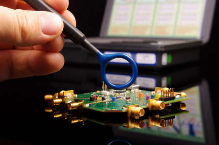 Electromagnetic compatibility (EMC) engineer holding magnetic near field probe for EMC troubleshooting and measurements
