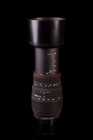 Professional macro zoom lens 70 mm - 300 mm for DSLR cameras isolated on the black background