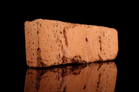 Clinker brick for house facade decor isolated on the black background Standard-Bild
