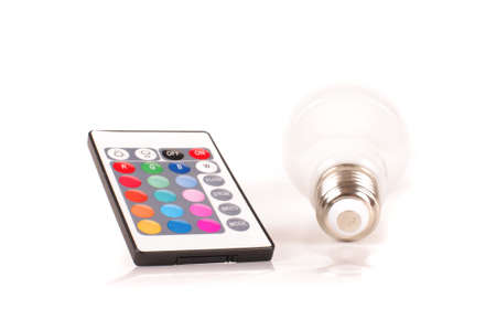 Remote control for light emitting diode LED theme light bulb isolated on the white background