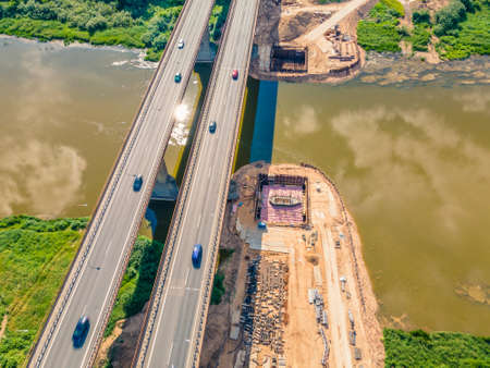 Aerial view of bridge construction works. New bridge is being built next to the old one.