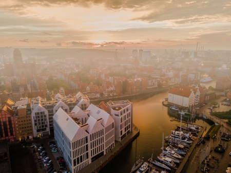 Aerial sunset view of the amazing old town of Gdansk (Poland), member of Hanseatic League with ships and yachts in the river