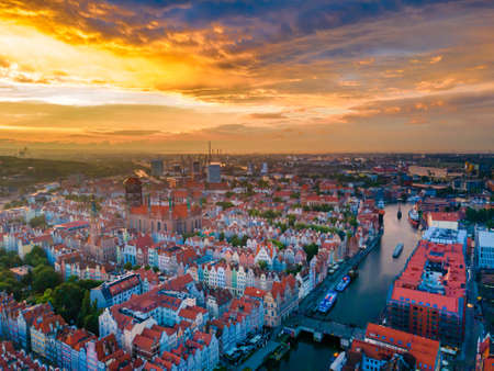 Aerial sunset view of the amazing old town of Gdansk (Poland), member of Hanseatic League with ships and yachts in the river Imagens