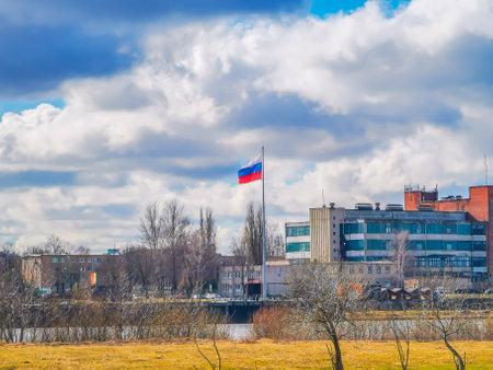Russian flag on a high mast in Kaliningrad seen from Lithuanian Republic Standard-Bild