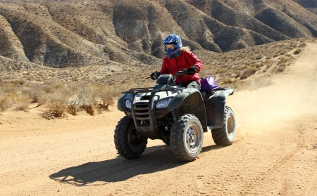 Woman driving an ATV  All Terrain Vehicle   photo