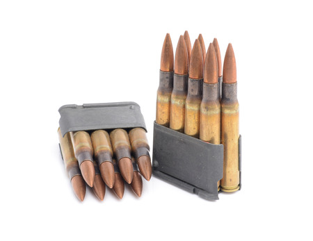 World War II M1 Garand Clips and 30-06 ammunition on white background. Stock Photo