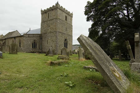 english village: English village church with graveyard